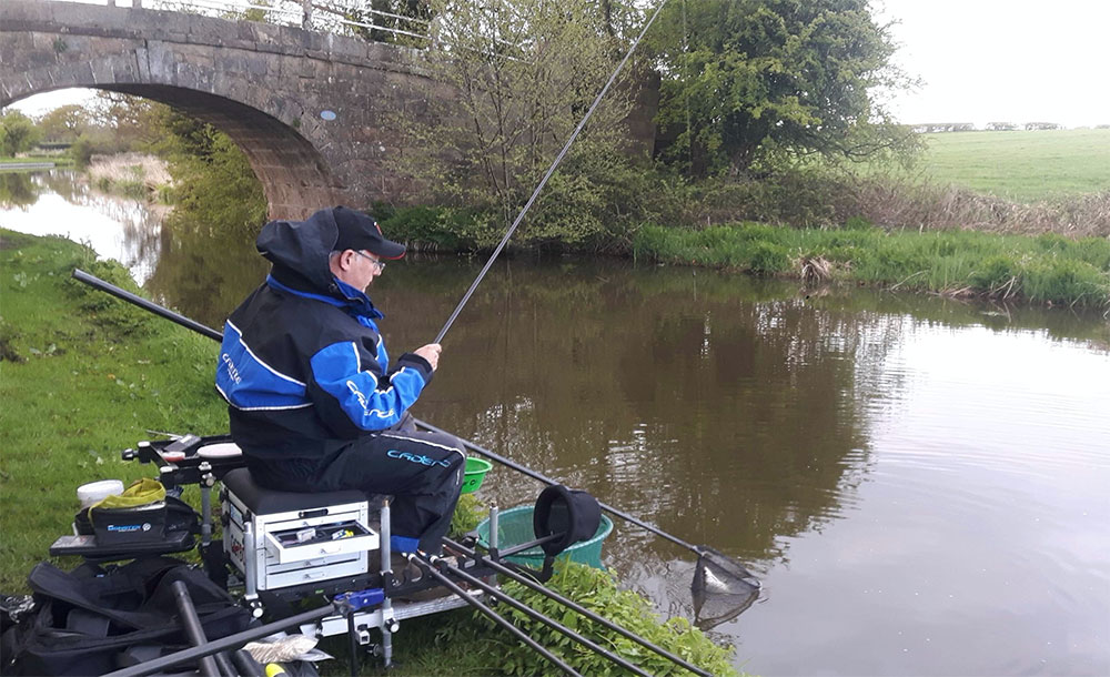 Alan pans a caster fish on the Lancaster Canal.